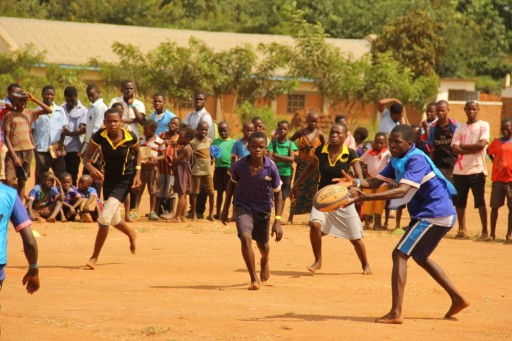 Children are used to playing on dirt, with no facility, limited local coaching and limited equipment and resources
